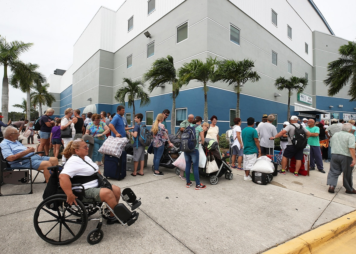 People wait to enter the Germain Arena, which has served as a shelter from Hurricane Irma, on Saturday in Estero, Florida. Even as economic losses from disasters have risen, the number of human lives lost has dropped.