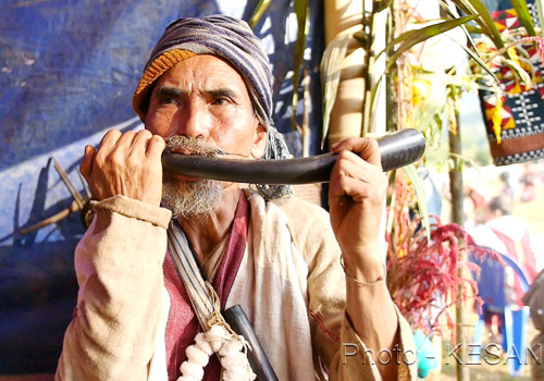An old Karen with his traditional instrument. Photo - KESAN/Supplied