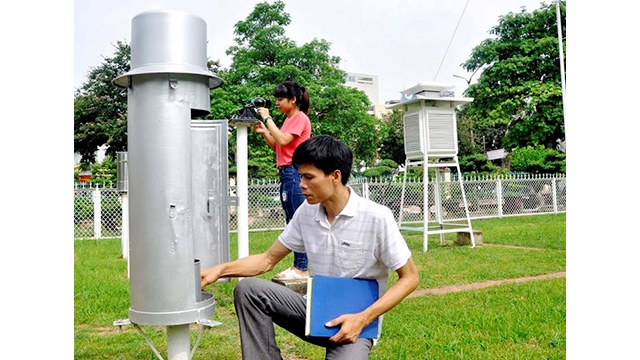 Officials at Vinh Phuc province's Hydro-Meteorological Station monitor weather changes.