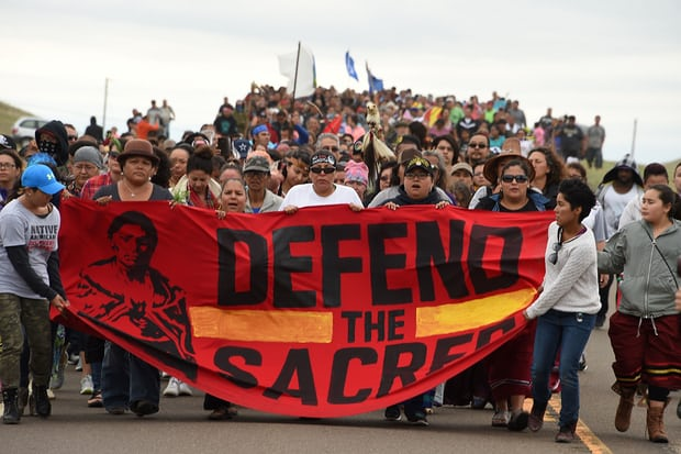 Native Americans march to a sacred burial ground disturbed by bulldozers building the Dakota Access Pipeline. Protesters were attacked by dogs and sprayed with a respiratory irritant when they arrived at the site. Photograph: Robyn Beck/AFP/Getty Images