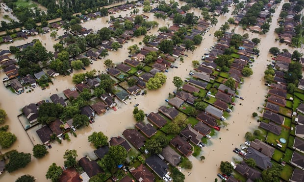 Residential neighbourhoods near Interstate 10 are flooded in the wake of Hurricane Harvey. Photograph: Marcus Yam/LA Times via Getty