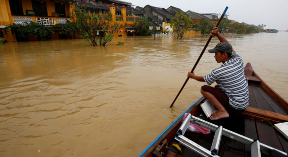 A man rides a boat along the overflowing Thu Bon river in Hoi An after typhoon Damrey hits Vietnam: the effects of climate change are intensifying extreme weather events in the country (photo: Kham/Reuters/Newscom)
