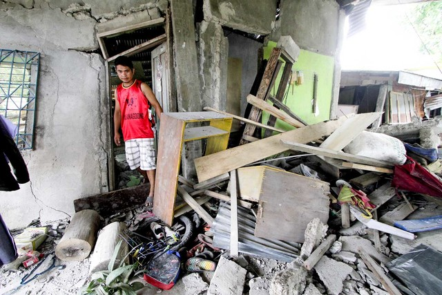 LEYTE EARTHQUAKE. A resident surveys his damaged house in Ormoc City following the magnitude 6.5 earthquake on July 6, 2017. File photo by Gelo Litonjua