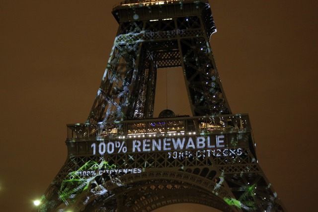 In this Sunday, Nov. 29, 2015 file photo, an artwork entitled 'One Heart One Tree' by artist Naziha Mestaoui is displayed on the Eiffel tower ahead of the 2015 Paris Climate Conference, in Paris. At least 20 countries are expected to formally join the Paris Agreement on climate change this week, greatly improving the pact's chances of coming into force just a year after it was negotiated in the French capital, U.N. officials say. AP/Thibault Camus, File