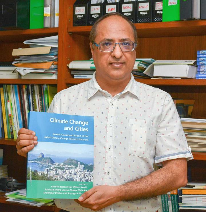 "DR. SHOBHAKAR DHAKAL WITH HIS NEW PUBLICATION ""CLIMATE CHANGE AND CITIES: SECOND ASSESSMENT REPORT OF THE URBAN CLIMATE CHANGE RESEARCH NETWORK. "" CREDIT: ASIAN INSTITUTE OF TECHNOLOGY (AIT)"