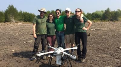The BioCarbon Engineering team and their double propeller quadro-copter drone they hope will mean a brighter future for Myanmar's depleted mangroves [Ivan Ogilvie/ Al Jazeera]