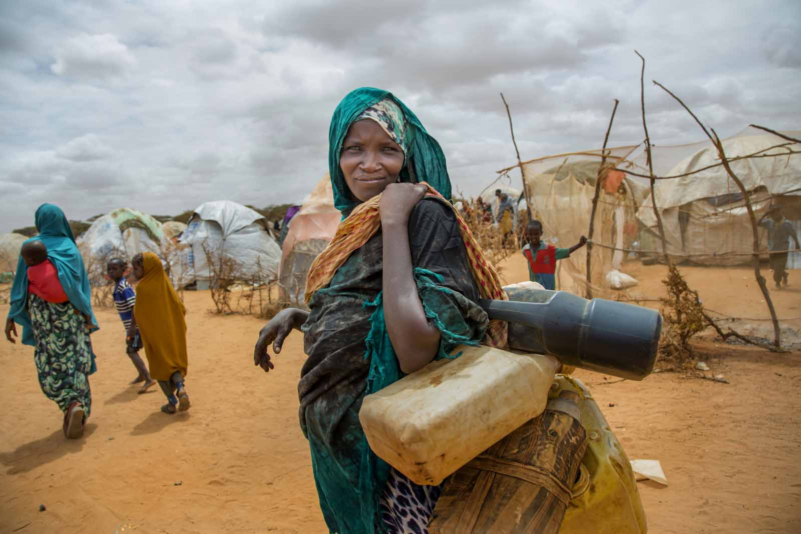 A photo on the Everyday Climate Change Instagram feed shows a Somali woman walking to collect water in Kapasa IDP Camp in Jubaland in June 2017. Photo by Georgina Goodwin