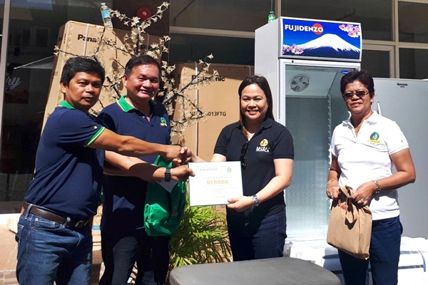 LAMAC MPC officials Mr. Richard Obaner (leftmost), Vice-Chair, and Mr. Delfin Tuguib (second from left), Chair, together with Ms. Maria Elena Limocon (rightmost), LAMAC MPC General Manager, presents the certificate of appreciation for the provision of equipment to The Dairy Box - Cebu to Ms. Nancy Landicho, SEARCA Program Specialist and OIC.