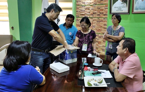 Mr. Edmund Ubaldo (standing, leftmost), Purchaser, turns over the Lactosan Milk Analyzer to the Rosario Dairy Raisers' Association on 14 March 2018 in the municipal hall of Rosario, Batangas.