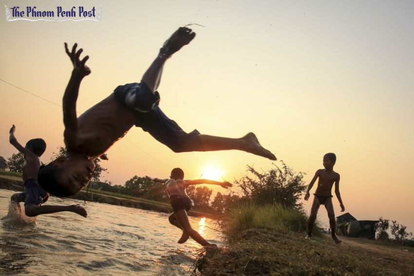 Children try to escape the afternoon heat by playing in a canal in Kandal province earlier this year. Vireak Mai