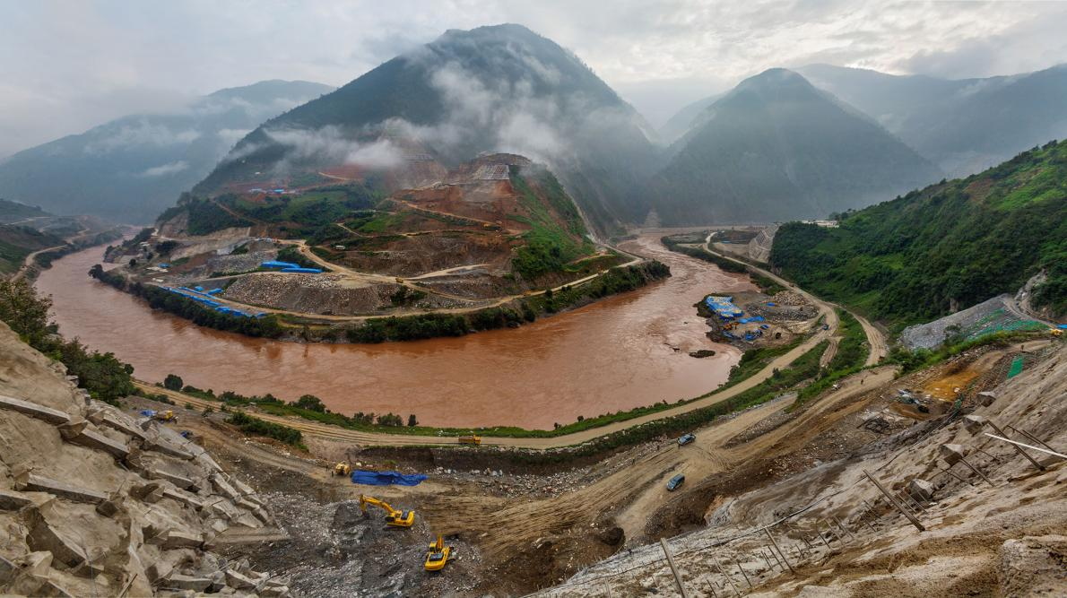 In 2012, when this photo was taken, construction of the Miaowei Dam was already underway. When finished next year, it will be the eighth dam on the Lancang River, China's name for its 1,300-mile stretch of the Mekong. PHOTOGRAPH BY DAVID GUTTENFELDER, AP/NATIONAL GEOGRAPHIC CREATIVE