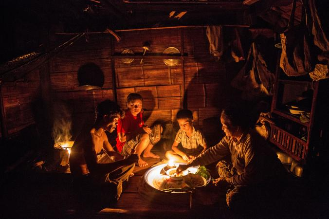 In Ban Khok Yai, along the Mekong River, three generations in the same family share dinner by candlelight. Their village will be inundated when the nearby Xayaburi dam is completed. PHOTOGRAPH BY DAVID GUTTENFELDER, AP/NATIONAL GEOGRAPHIC CREATIVE