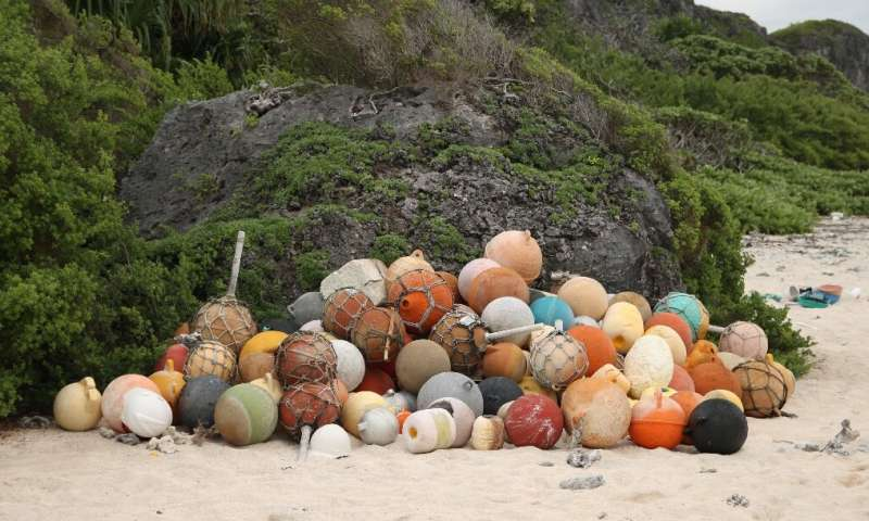 A pile of collected fishing bouys on a beach on Henderson Island, an uninhabited part of the Pitcairn archipelago in the South Pacific Ocean