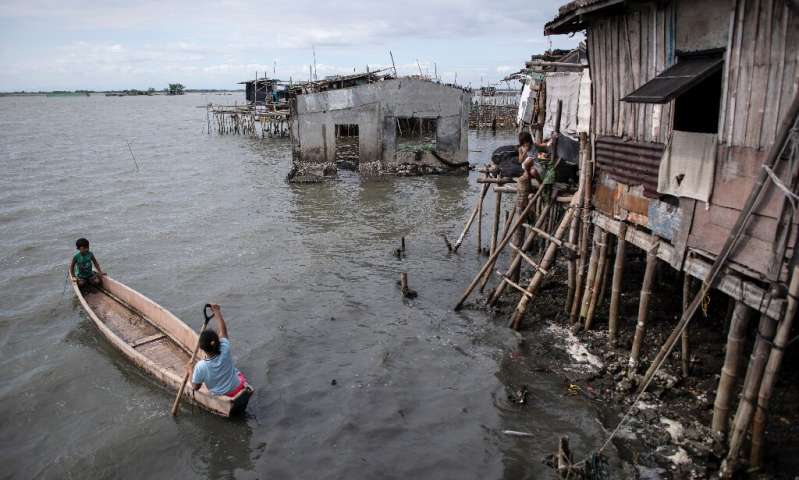 At least 5,000 people have been forced out of the mostly rural coastal areas north of Manila in recent decades as the bay water has moved further inland, regional disaster officials told AFP