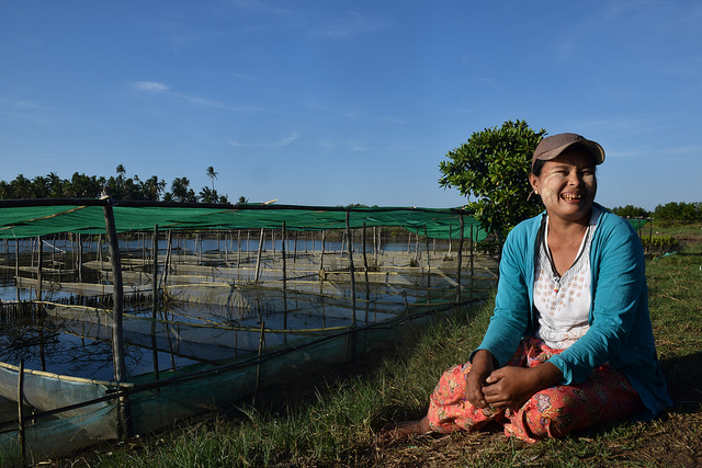 Clam farmer Thein Thein Sein is full of happiness as she looks upon her zero-investment clam farm in Myagi village of Shwe Thaung Yan sub township in Ayyerwady region of Myanmar. Credit: Stella Paul/IPS