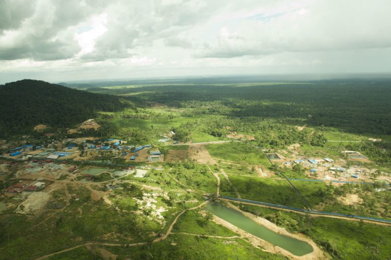 A drone photo shows a gold mine site and surrounding forest and farmland. Image courtesy of Mother Nature Cambodia