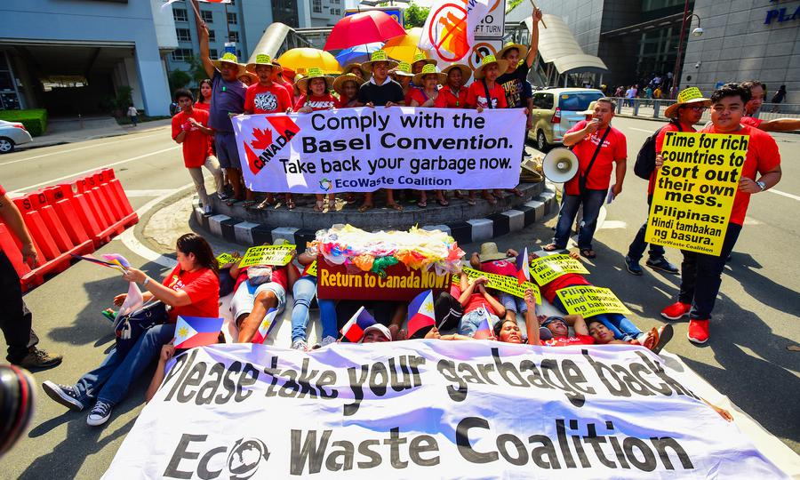 Activists from EcoWaste protest outside the Canadian embassy in Manila on May 21, 2019, to push the Trudeau government to speed up the removal of waste from Manila and Subic ports. Photo: AFP / Maria Salvador Tan
