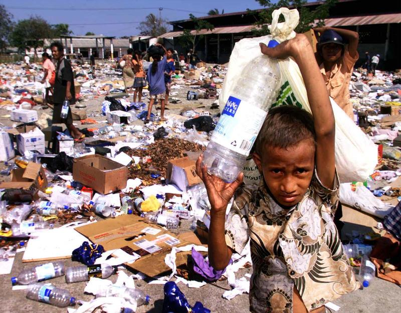 FILE PHOTO - East Timorese collect plastic containers and leftovers at a garbage dump in Dili September 27.