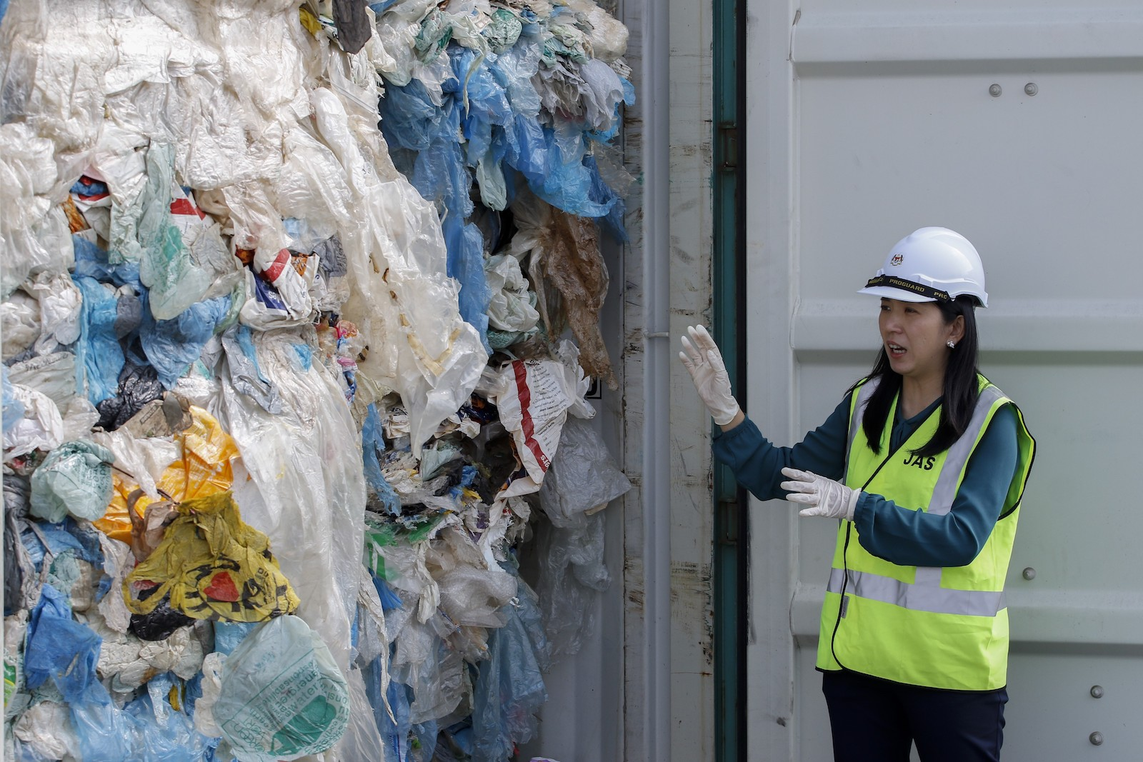 Malaysia's Minister for the Environment and Climate Change Yeo Bee Yin shows plastics waste shipped from Canada before it was sent back on May 28, 2019. Photo: AFP via Andalou/Adli Ghazali