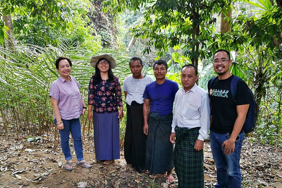 The ASRF PMO and Dr. Dr. Ei Ei Swe Hlaing, AWG-SF Focal Point and Assistant Director of FRI (second from left), with members of the village community in Than Daung Township.